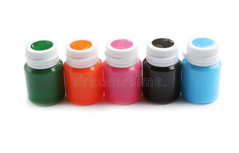Опарникы с красочными красками на белой предпосылке художническое оборудование стоковое фото