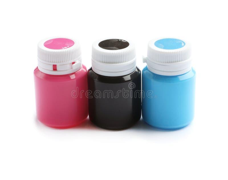 Опарникы с красочными красками на белой предпосылке стоковые изображения rf