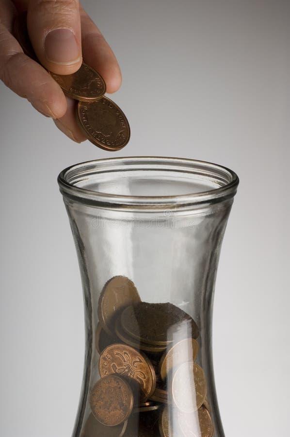 опарник монетки стоковые изображения