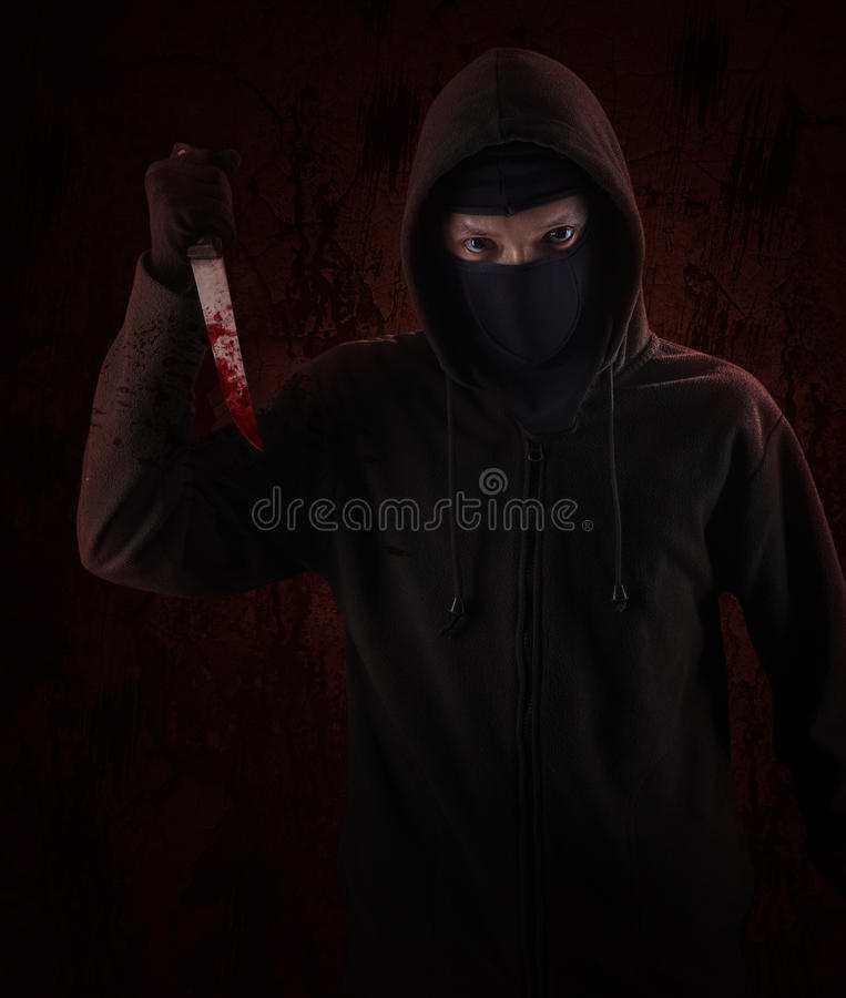 Опасный с капюшоном человек стоковые изображения