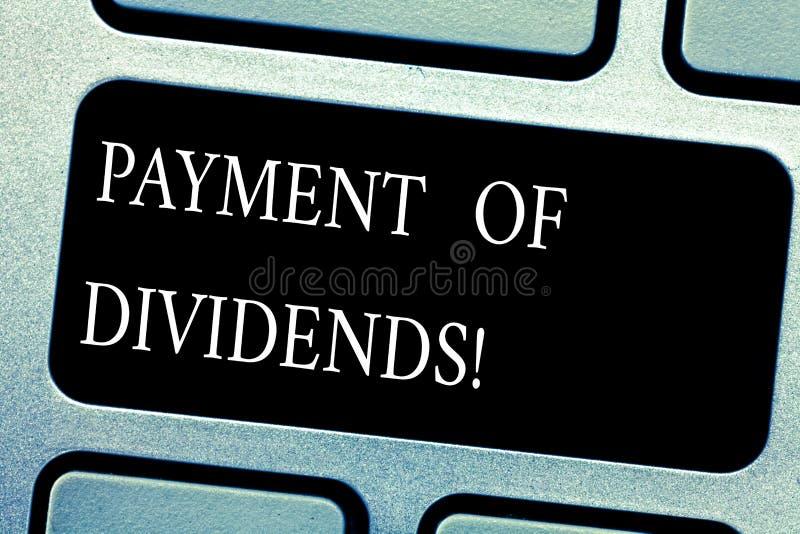 Оплата текста почерка дивидендов Концепция знача распределение выгод компанией к клавиатуре акционеров стоковое изображение rf