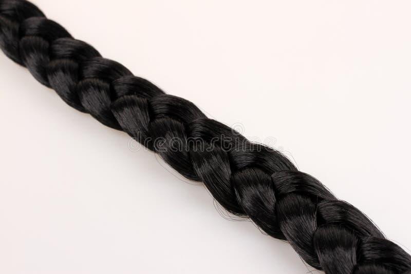 Оплетка черных волос стоковые фото