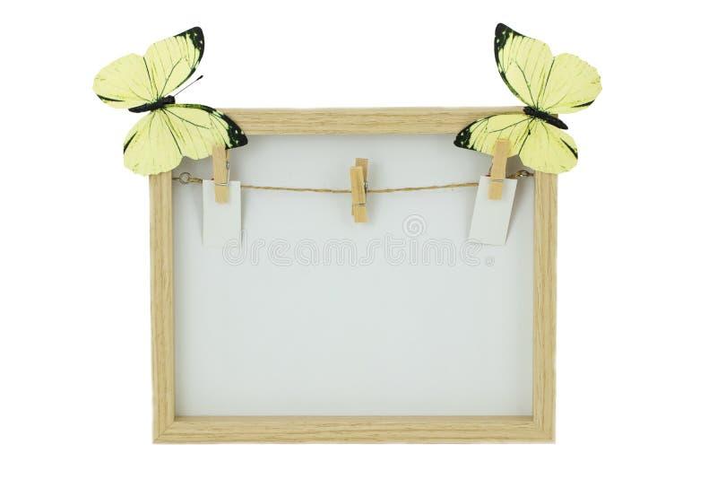 Опорожните деревянную рамку с веревкой для белья и зажимки для белья на bac стоковое фото rf