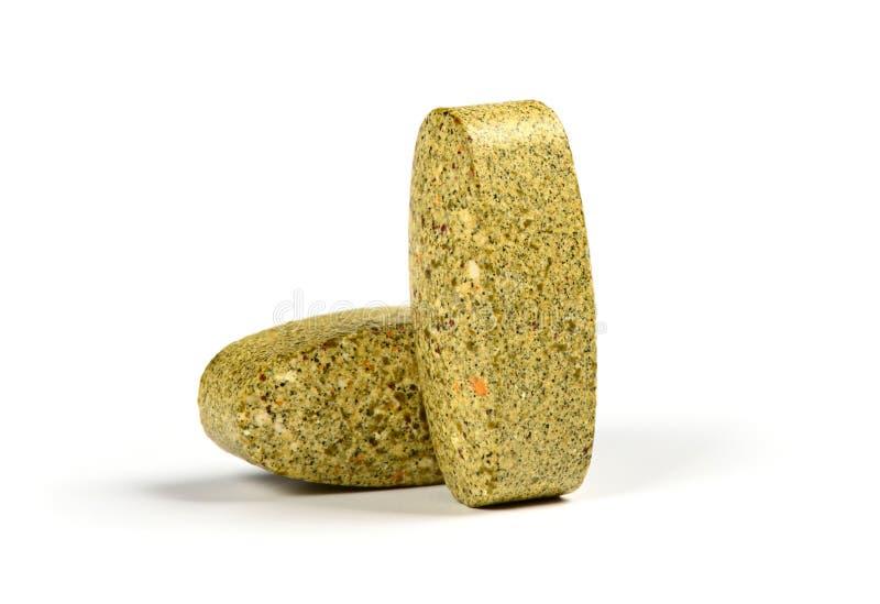 дополнения Травяные витамины на белой предпосылке стоковое фото rf