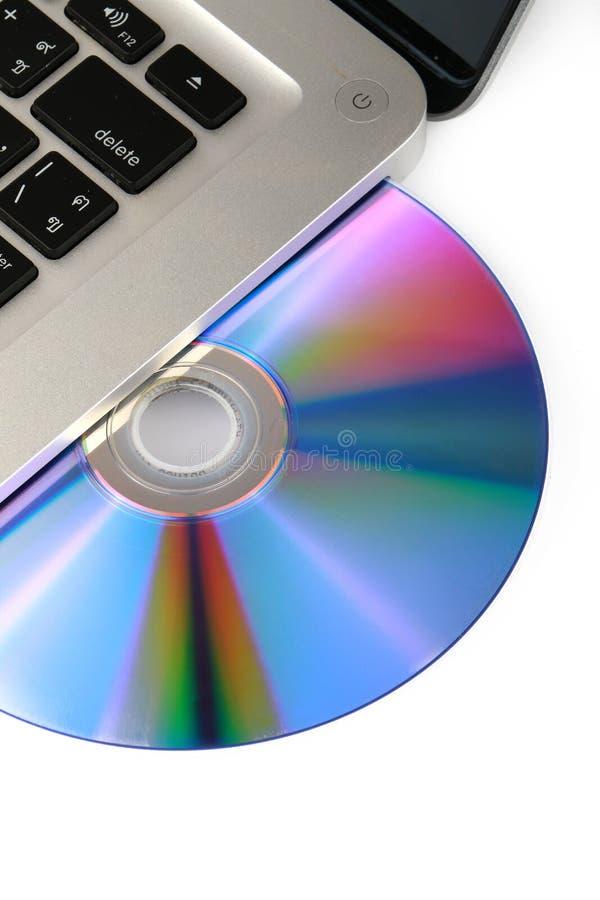 Оптически DVD, CD-привод на портативном компьютере на белой предпосылке, изолированном конце-вверх, стоковое фото