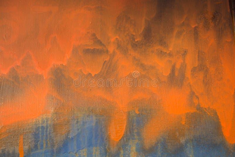 Оранжевая голубая предпосылка smudge краски стоковое фото rf