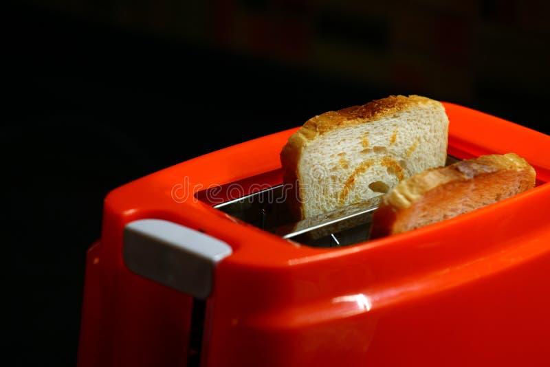 Оранжевая кухня здравицы тостера стоковая фотография rf