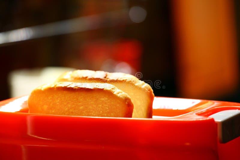 Оранжевая кухня здравицы тостера стоковая фотография