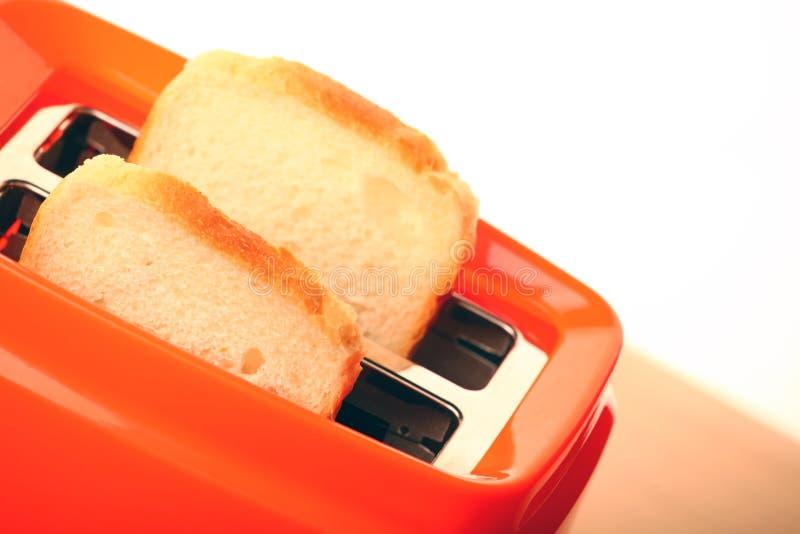 Оранжевое качество студии здравицы тостера стоковое изображение