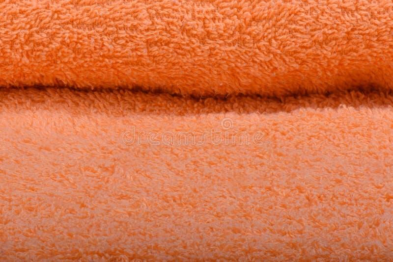 Оранжевое полотенце Terry Текстура полотенец ткани стоковые изображения