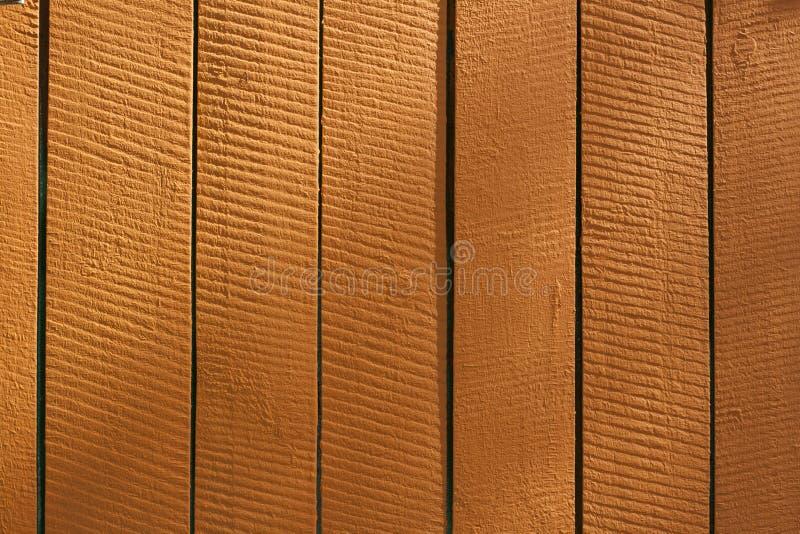 Оранжевые вертикальные деревянные решетины, предпосылка, текстура стоковые фото