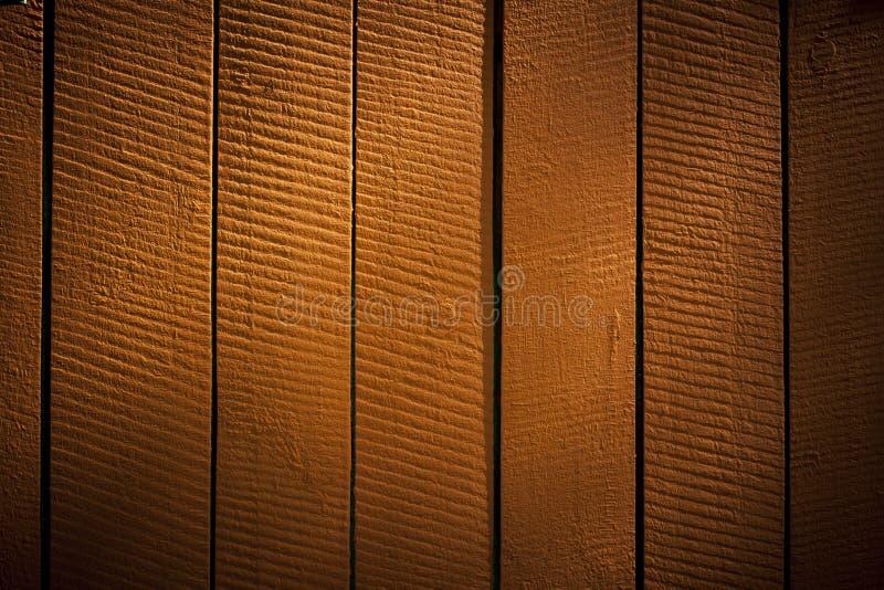 Оранжевые вертикальные деревянные решетины, предпосылка стоковая фотография