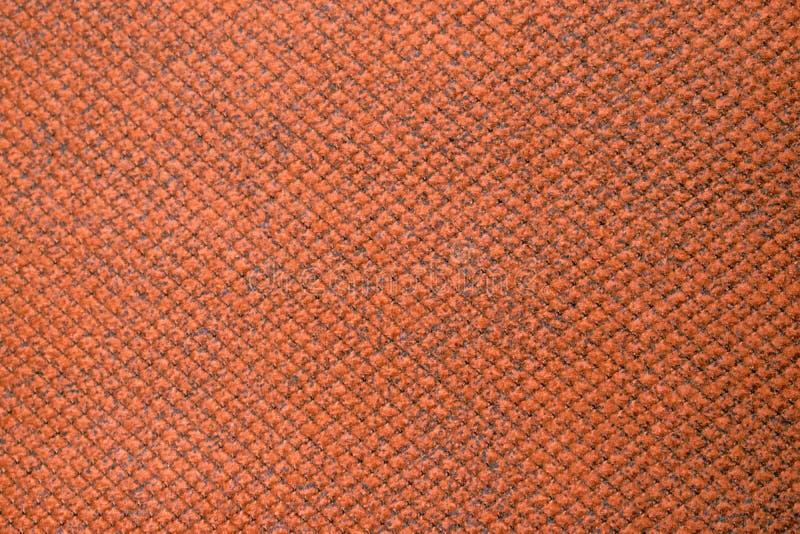 Оранжевые покрашенные образцы образца ткани текстурируют unprinted одевая ткань сверху Текстура ткани стоковые изображения rf