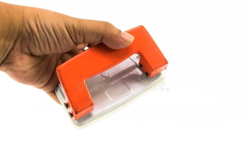 Оранжевый бумажный пунш на изолированной руке человека стоковое изображение rf