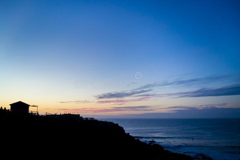 Download Оранжевый заход солнца на пляже Стоковое Фото - изображение: 92418682