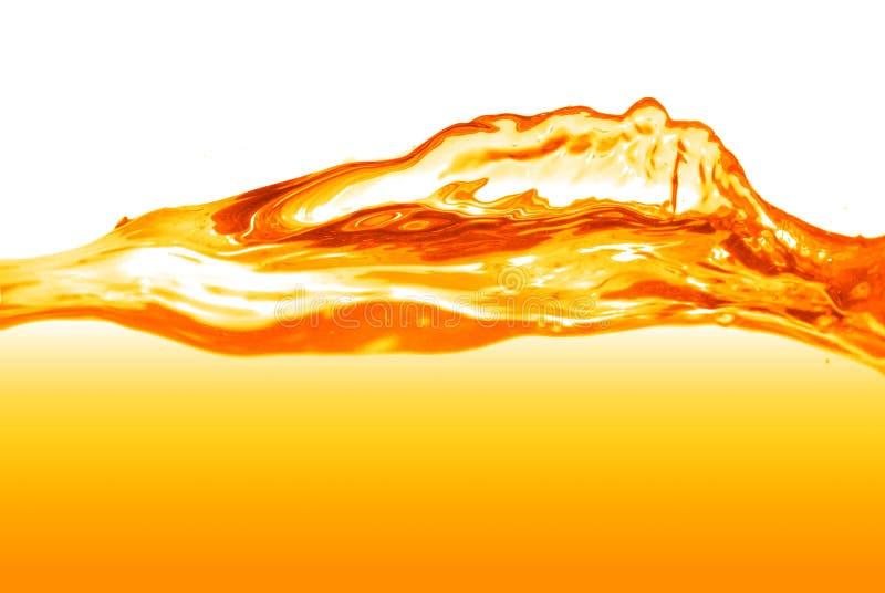 Оранжевый изолированный выплеск воды стоковые фотографии rf