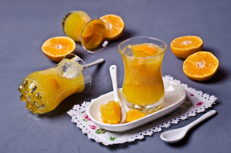 Оранжевый студень в стекле стоковое фото