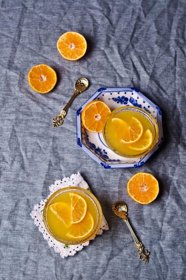 Оранжевый студень в стекле стоковые изображения