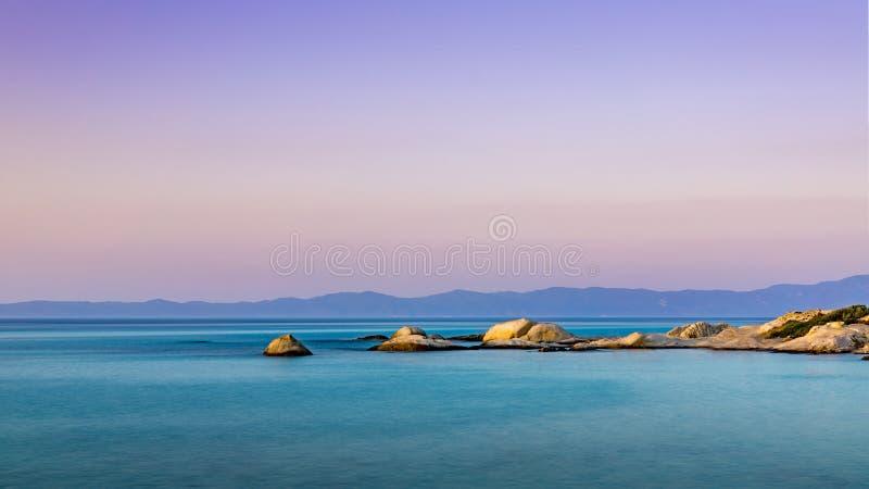 Оранжевый сумрак пляжа стоковые фотографии rf