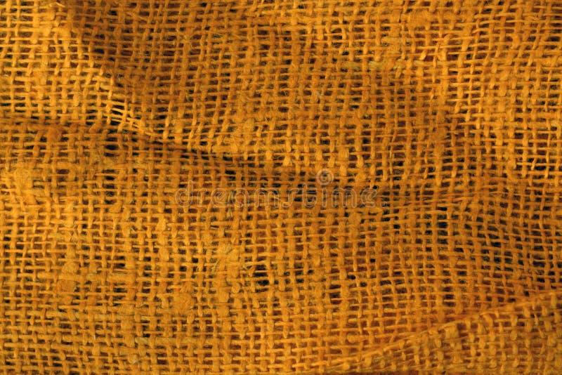 Оранжевым скомканная цветом поверхность ткани бесплатная иллюстрация