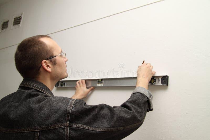 оригинал измеряет стену стоковые фото