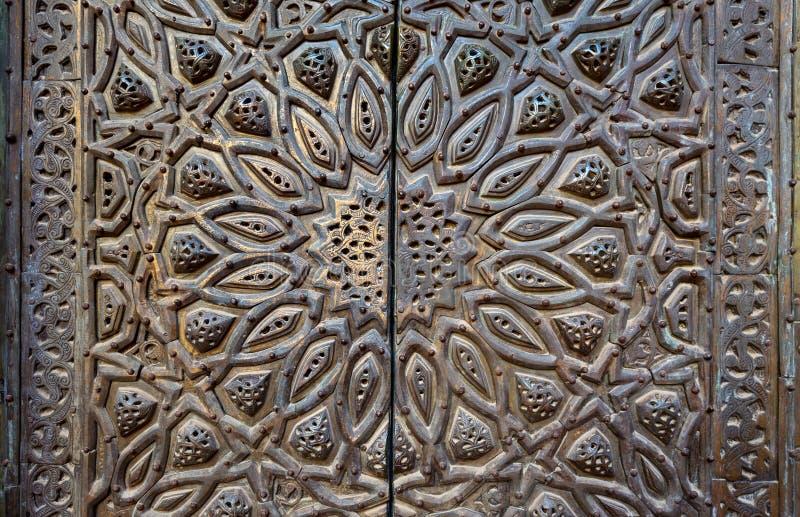 Орнаменты двери бронз-плиты богато украшенной стоковая фотография rf