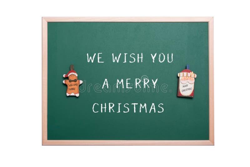 Орнамент человека хлеба Санта Клауса и имбиря на зеленой доске стоковое фото rf