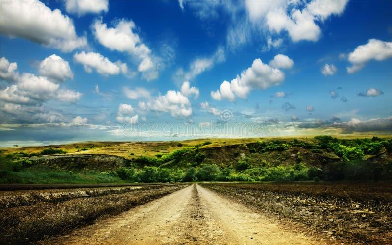 дорога гор поля сельская стоковое изображение