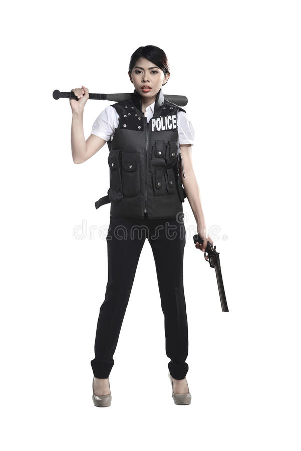 Оружие и бейсбольная бита револьвера владением женщины полиции стоковые изображения rf