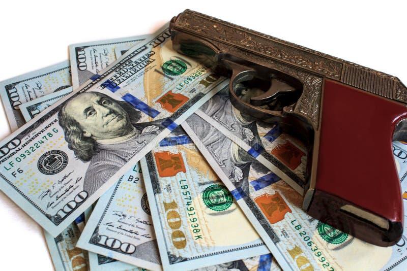 Оружие, концепция, деньги, доллар, преступник, дело, предпосылка, валюта, война, оружие, преступление, финансы, богатство, наличн стоковые фото