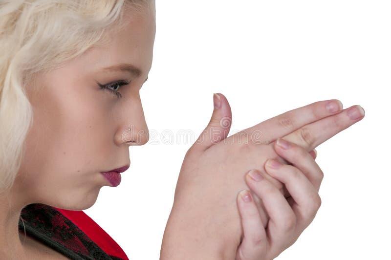Оружие пальца женщины стоковая фотография