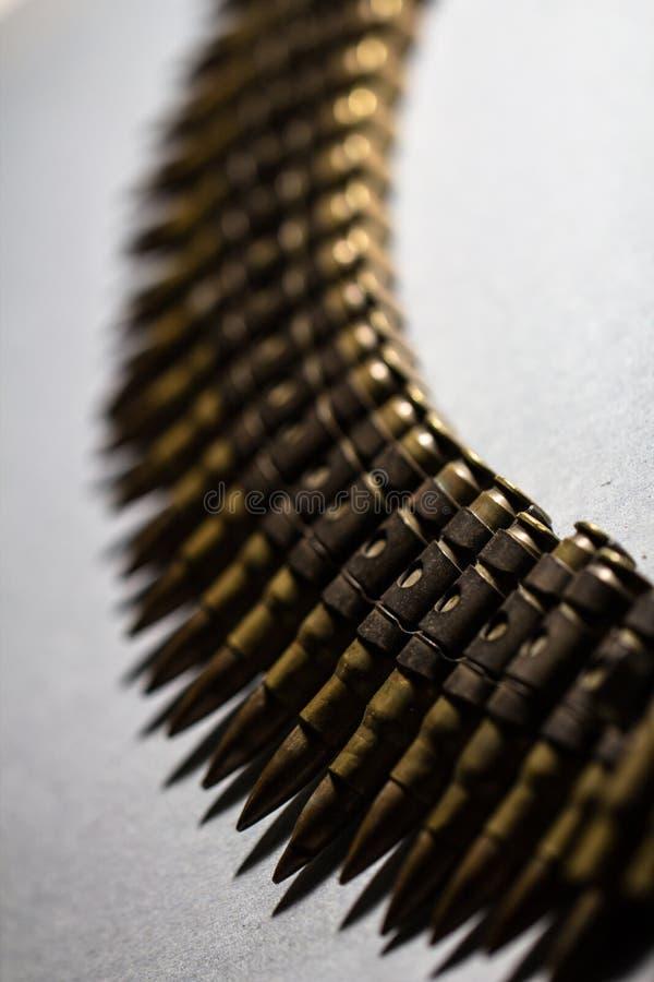 Оружие пули в линии поясе стоковые изображения