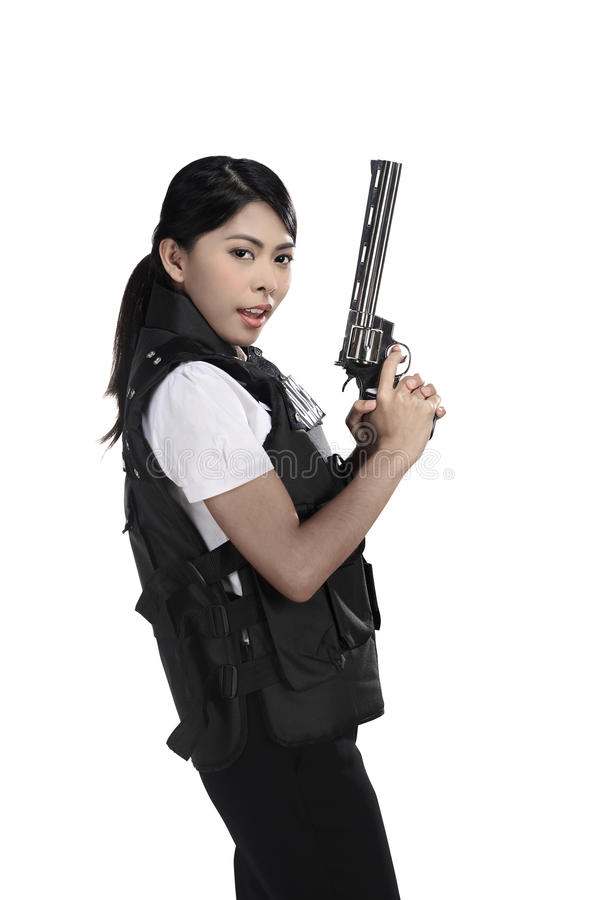 Оружие револьвера владением женщины полиции стоковые фото