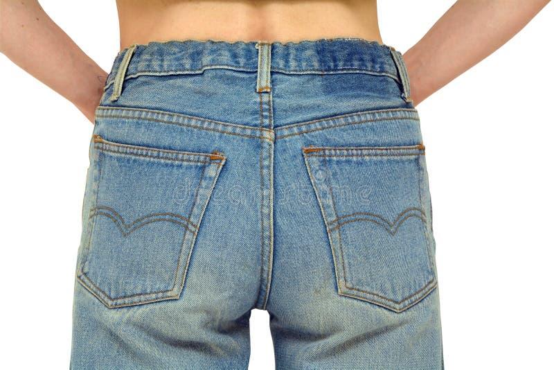 Оружия вид сзади джинсов стоковое фото rf