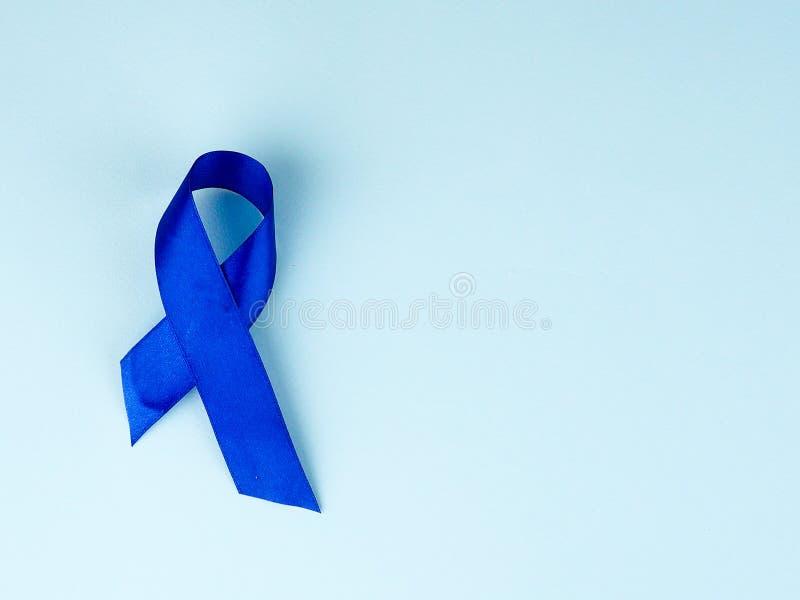 Осведомленность голубой ленты Рак толстой кишки, колоректальная Карцинома, осведомленность насилия над ребенком, день диабета мир стоковое изображение rf