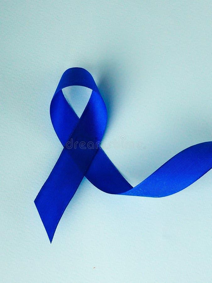 Осведомленность голубой ленты Рак толстой кишки, колоректальная Карцинома, осведомленность насилия над ребенком, день диабета мир стоковое фото