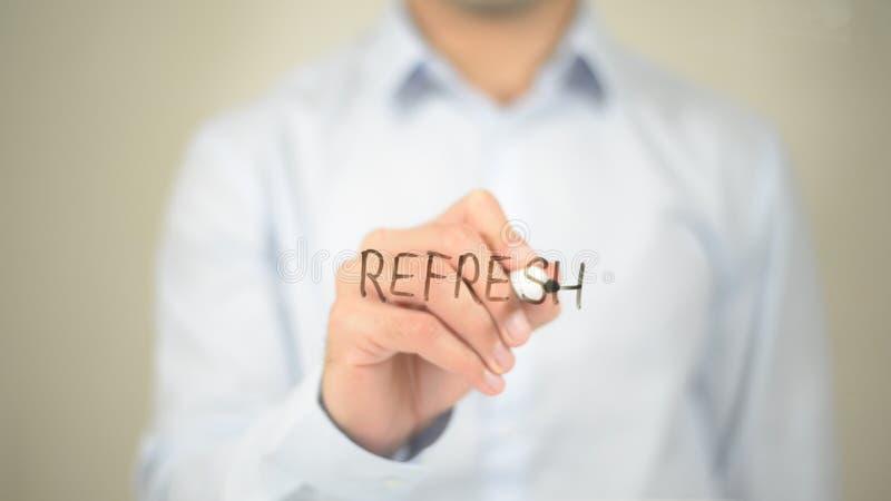 Освежите, укомплектуйте личным составом сочинительство на прозрачном экране стоковое фото rf