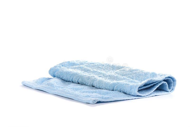 Осветите - голубое полотенце Terry изолированное на белой предпосылке стоковые изображения