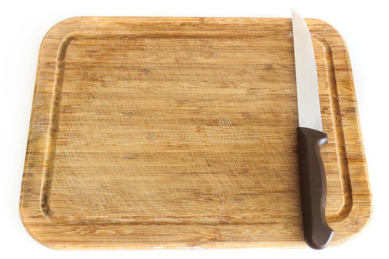 доска предпосылки прерывая изолированную белизну ножа стоковая фотография rf