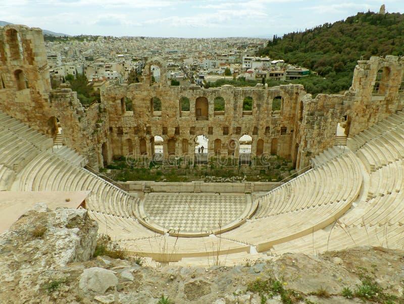 Остатки Odeon театра Аттика Herodes, акрополя Афина, Греции стоковые изображения