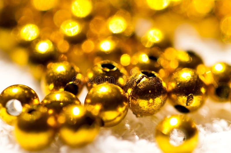 отбортовывает золотистую пластичную белизну стоковое изображение rf