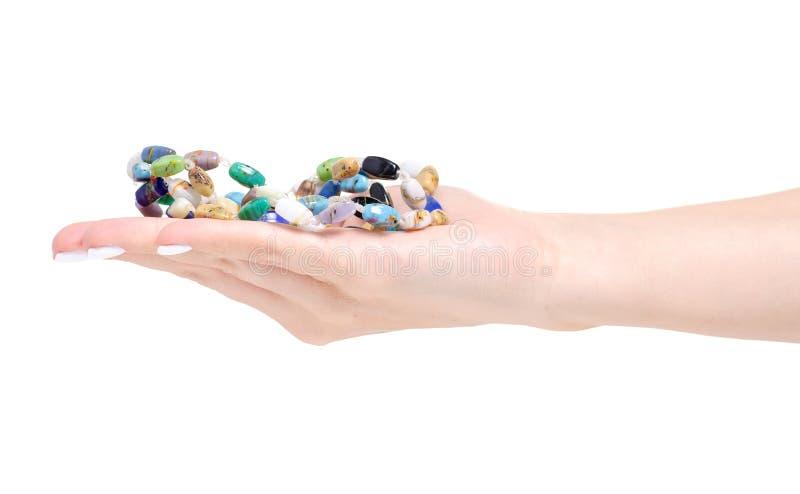 Отбортовывает красочные камни в руке стоковое изображение