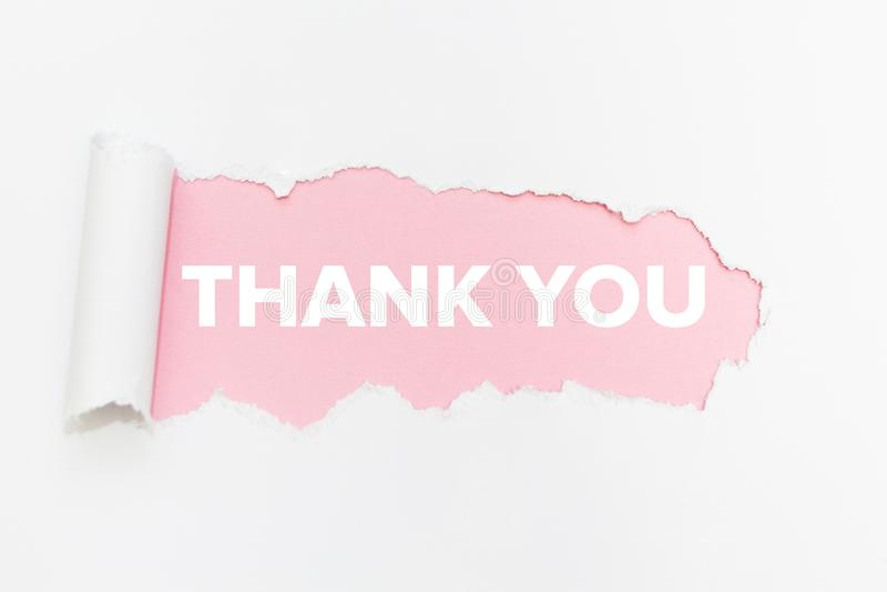 Отверстие бумаги прорыва на изолированной белой предпосылке Спасибо стоковая фотография