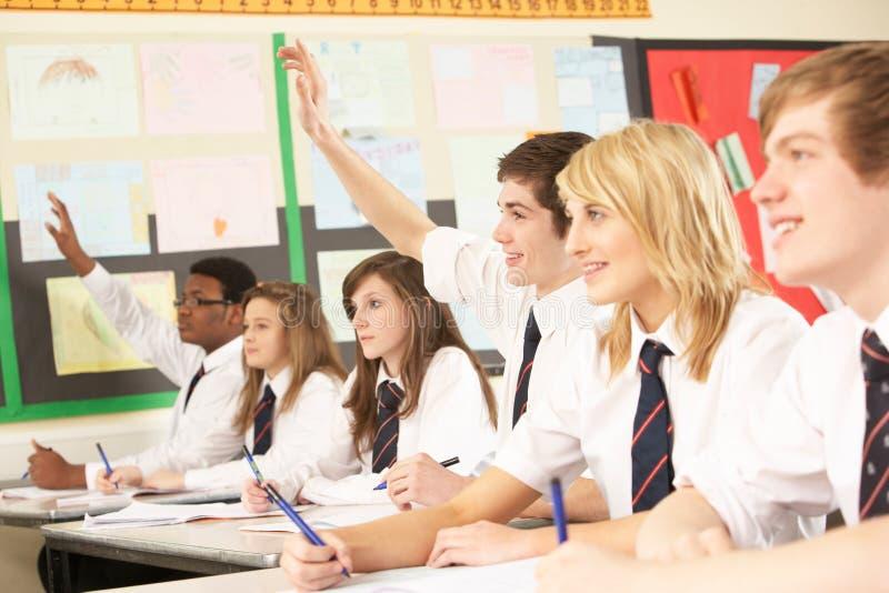 отвечая студент вопроса подростковый стоковое изображение