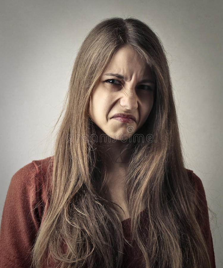 Отвращение показа девушки стоковое изображение