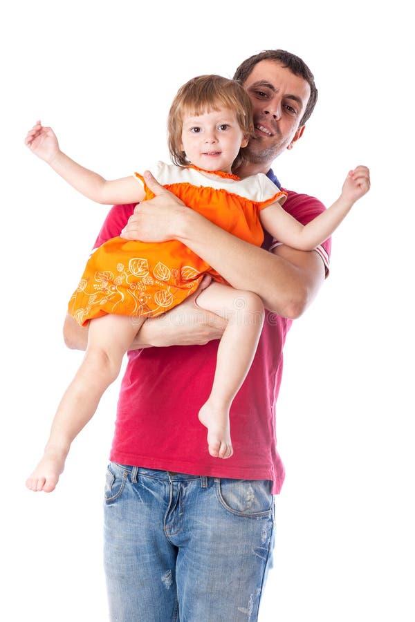 Отец держит его дочь стоковые изображения
