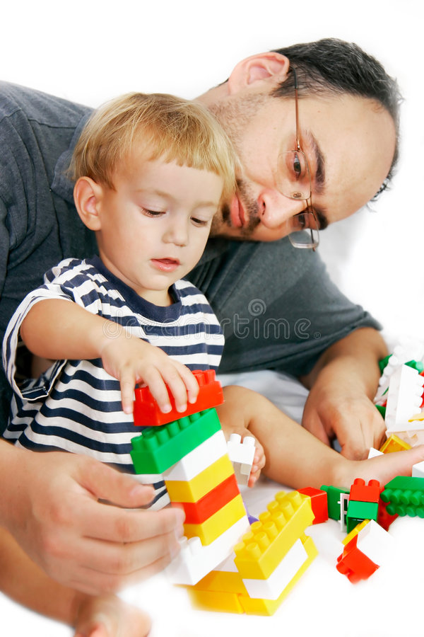 отец играя сынка стоковая фотография