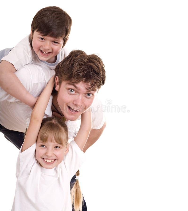 отец счастливые 2 семьи детей стоковая фотография rf