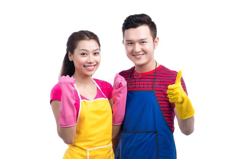 Отечественная команда обслуживания домоустройства Домашние люди азиата чистки стоковое изображение rf
