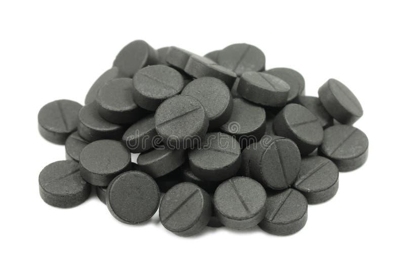 отжатые пилюльки активированного угля стоковое изображение